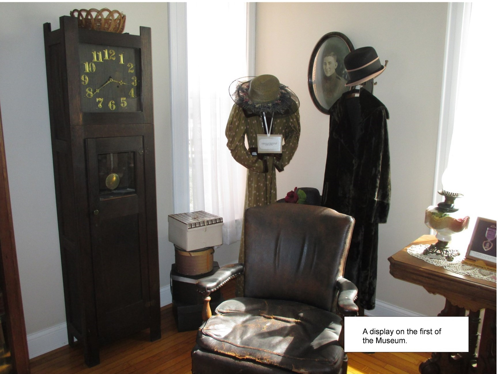 Picture of clothing,grandfather clock and chair